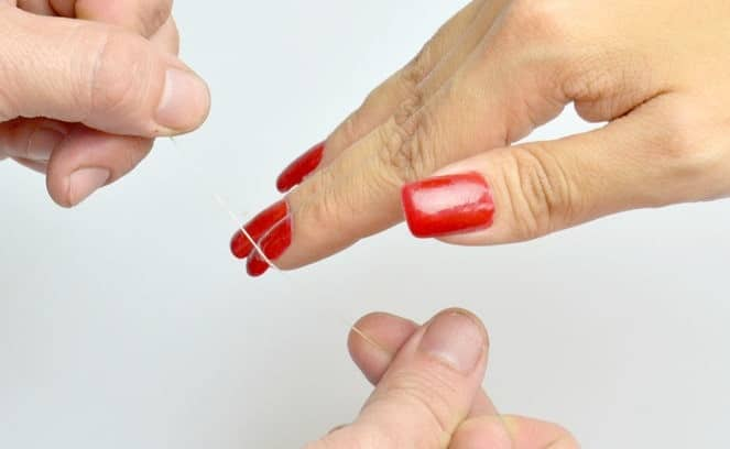 Remove The Acrylic Nails With Dental Floss