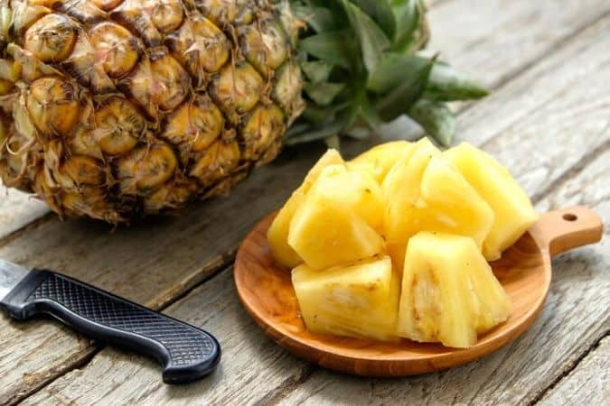 What part of pineapple should you give to dogs